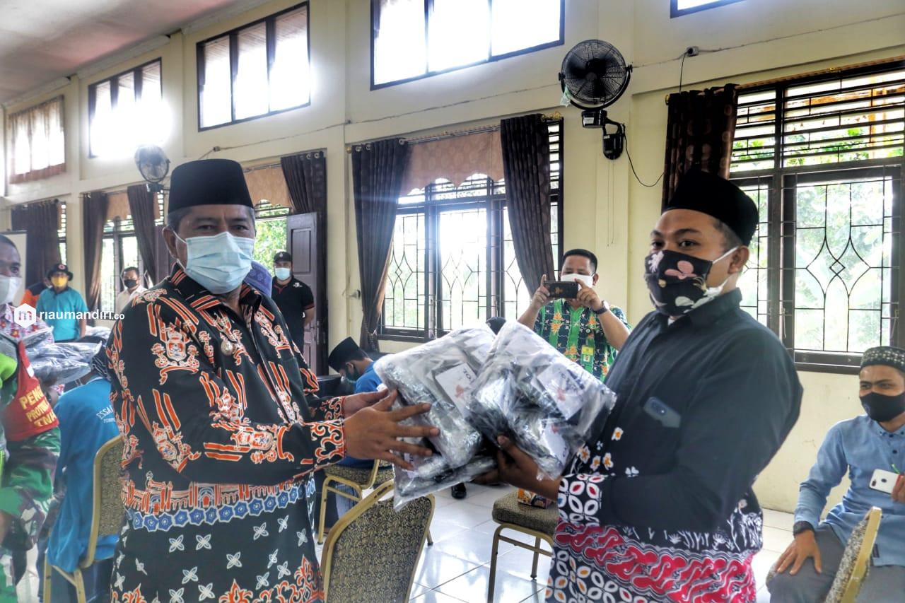 Bupati Siak Ingatkan Rumah Ibadah Sediakan Masker